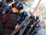 La gifle d'un policier constitue par principe un traitement dégradant